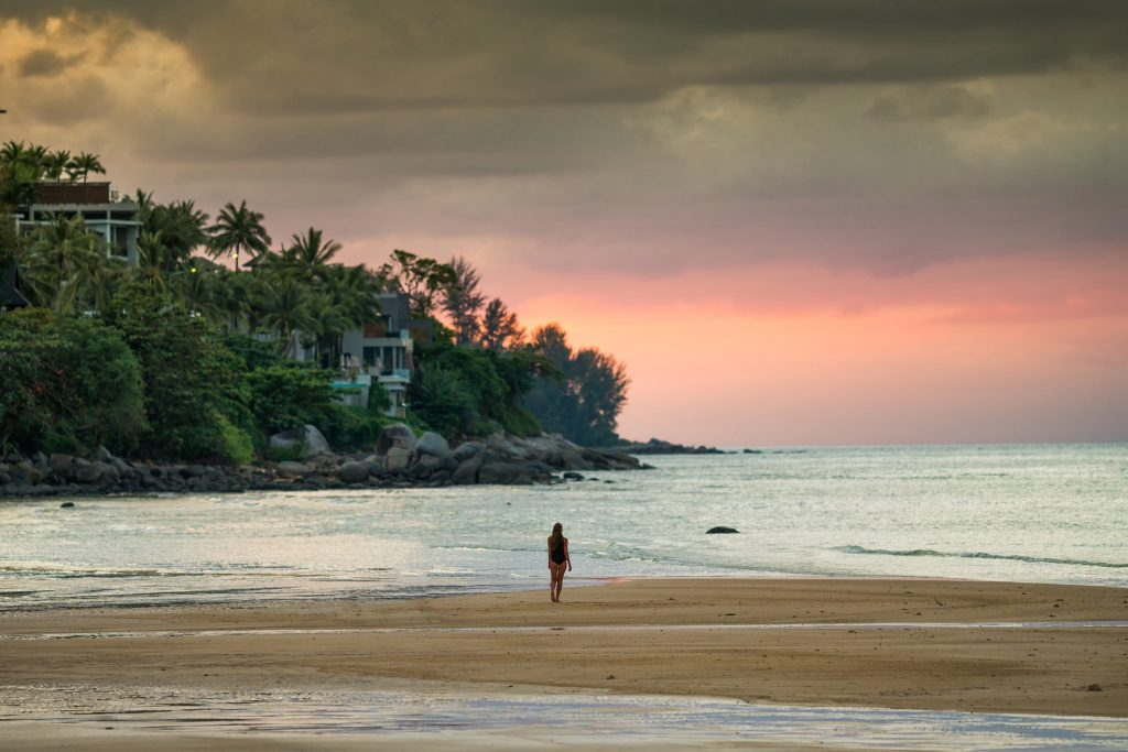 Lone girl on beach during sunset