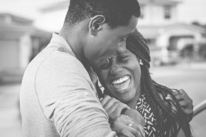 Black couple laughing in bw photo