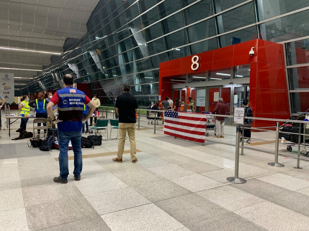 """""""The closed Delhi airport the night of my evac flight and the U.S. Embassy table and that beautiful American flag awaited everyone who had such a journey to get there. It was an amazing moment knowing I was now safe."""" Photo: Anietra Hamper"""