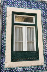 Portugal is famous for its blue tiles. The blue tiles that wrap this apartment window is very common. Photo: Manali Shah