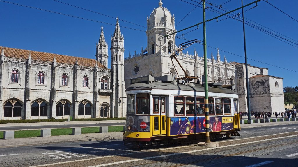 A tram traveling down a street in Portugal's capital, Lisbon.