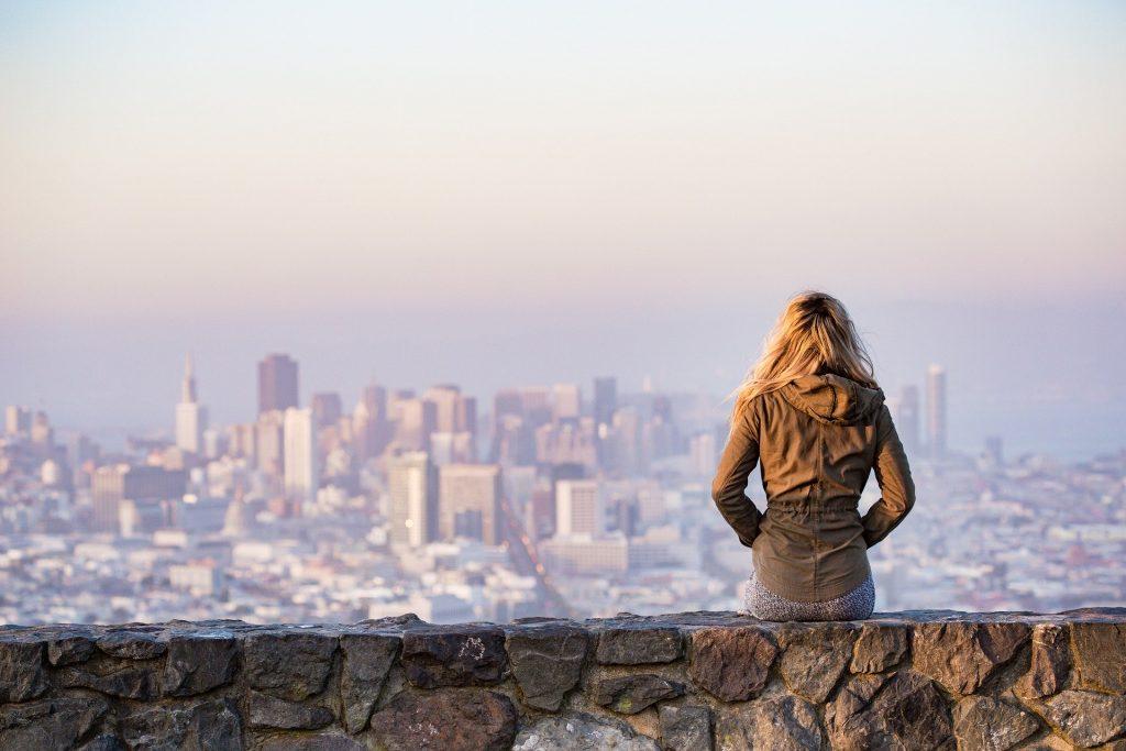 Traveler overlooking city