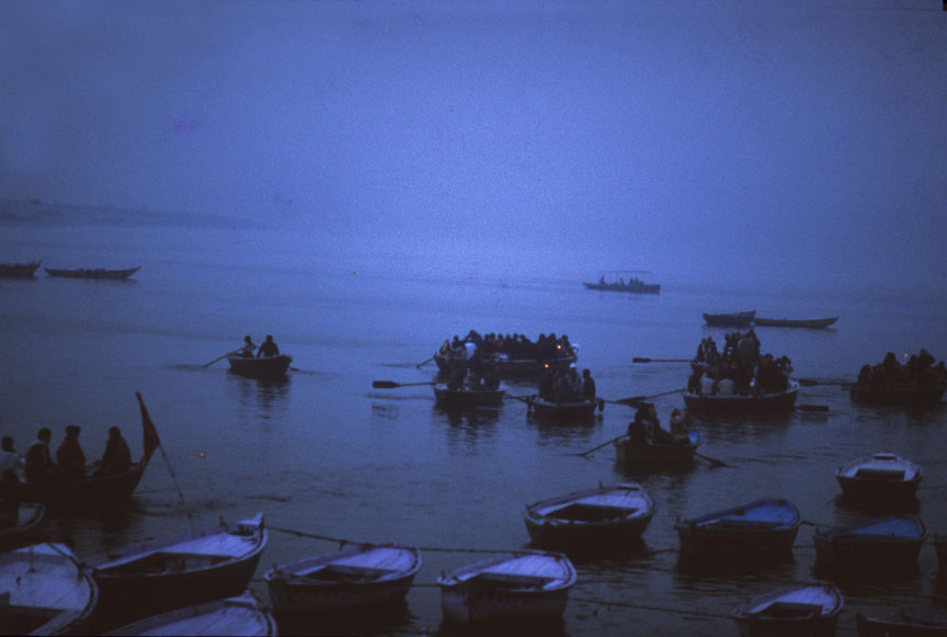 Country boats sail in the misty blue dawn. Photo: Sugato Mukherjee
