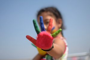 Little-girl-with-colorful-hand
