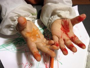 child-with-painted-hands