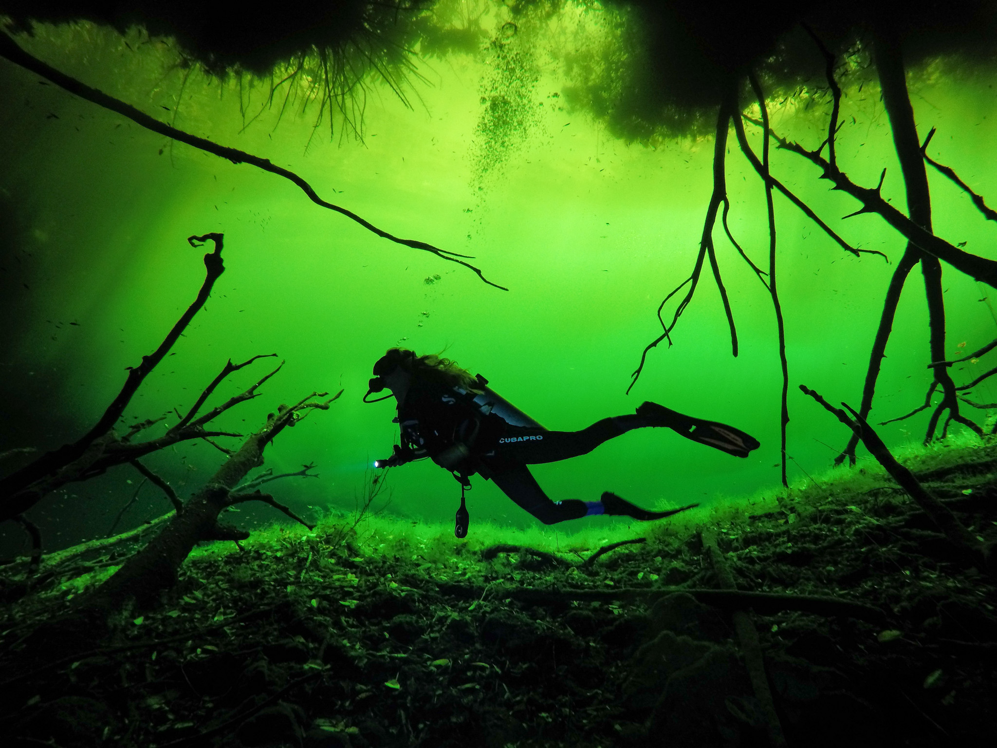 Author Kellie Paxian. Cenote diving in Tulum. Photo: @Tulum.breathtaking