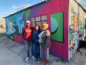 Heather with her guide and one of the tenants in the Khayelitsha township in Cape Town. Photo courtesy of Heather Markel