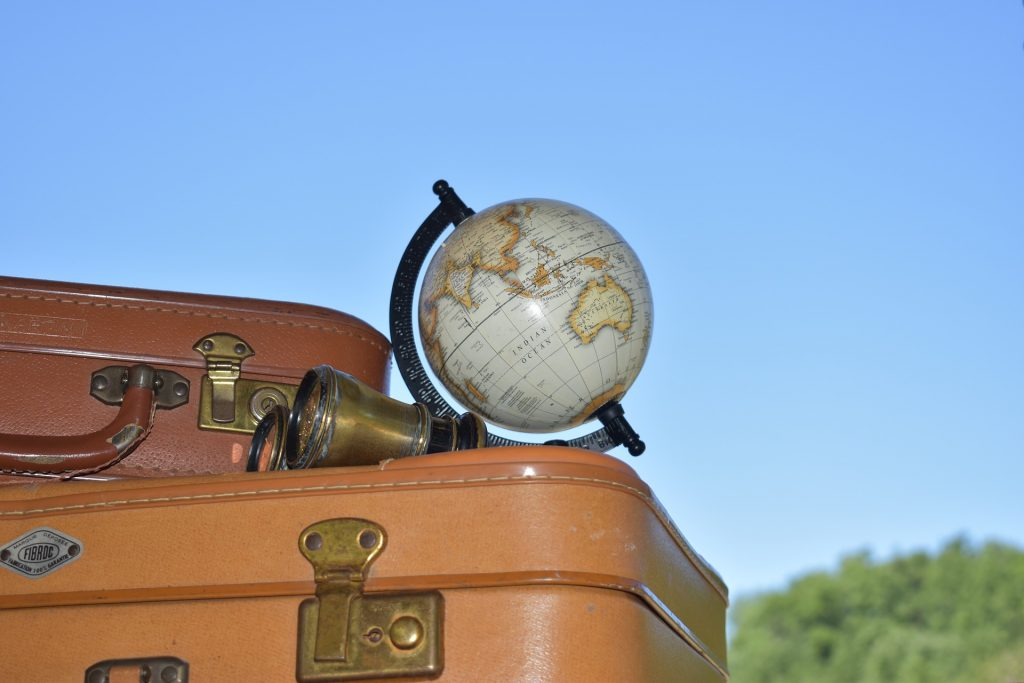 Missing travel with luggage and world globe