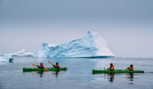 Antarctica by kayak photo courtesy of Rax from NomadsUnveiled.