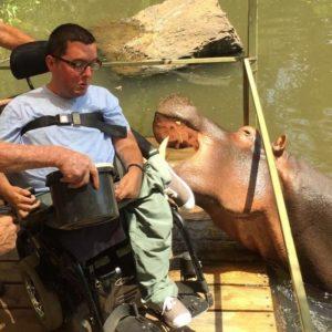 Cory Lee next to a Hippo