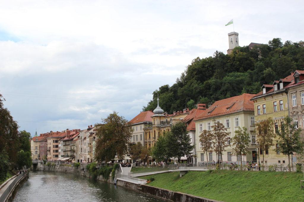 Ljubljana river walk with castle in background. Photo: Trixie Pacis