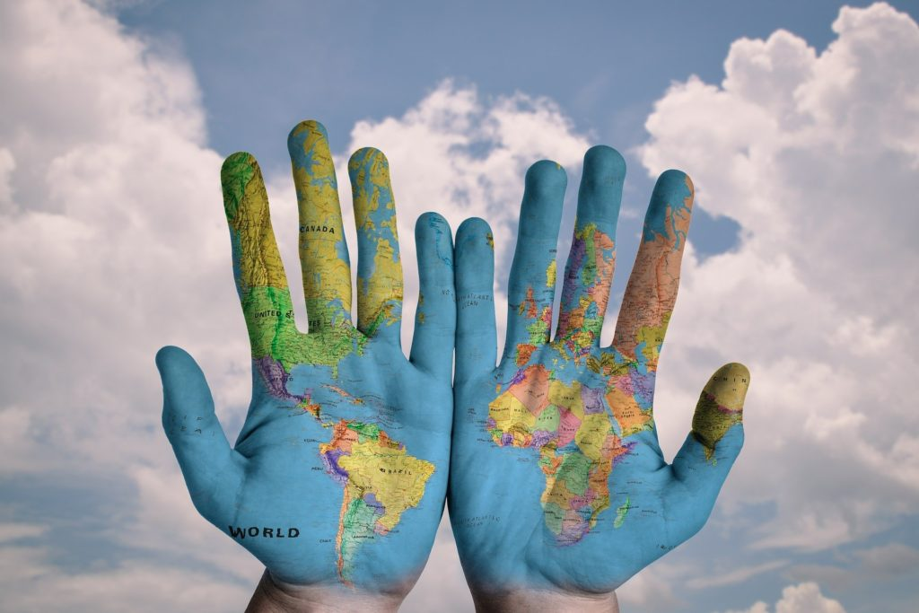 Compass - COVER World Map on hands
