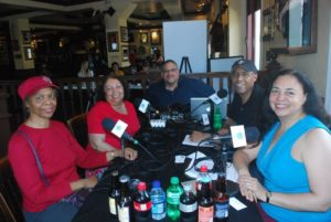 Podcast Guests- Our moms as podcast guests at the table of our World Footprints podcast live broadcast during French Quarter Festival.