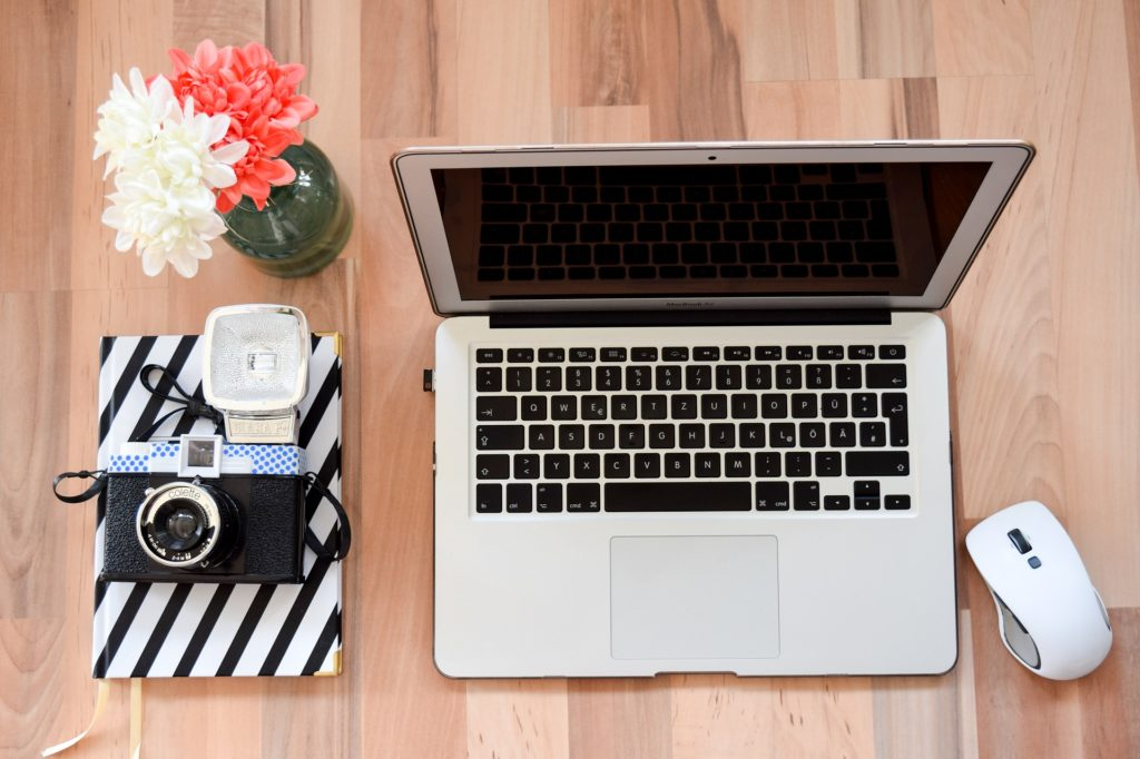 Laptop, camera and journal for freelance writer
