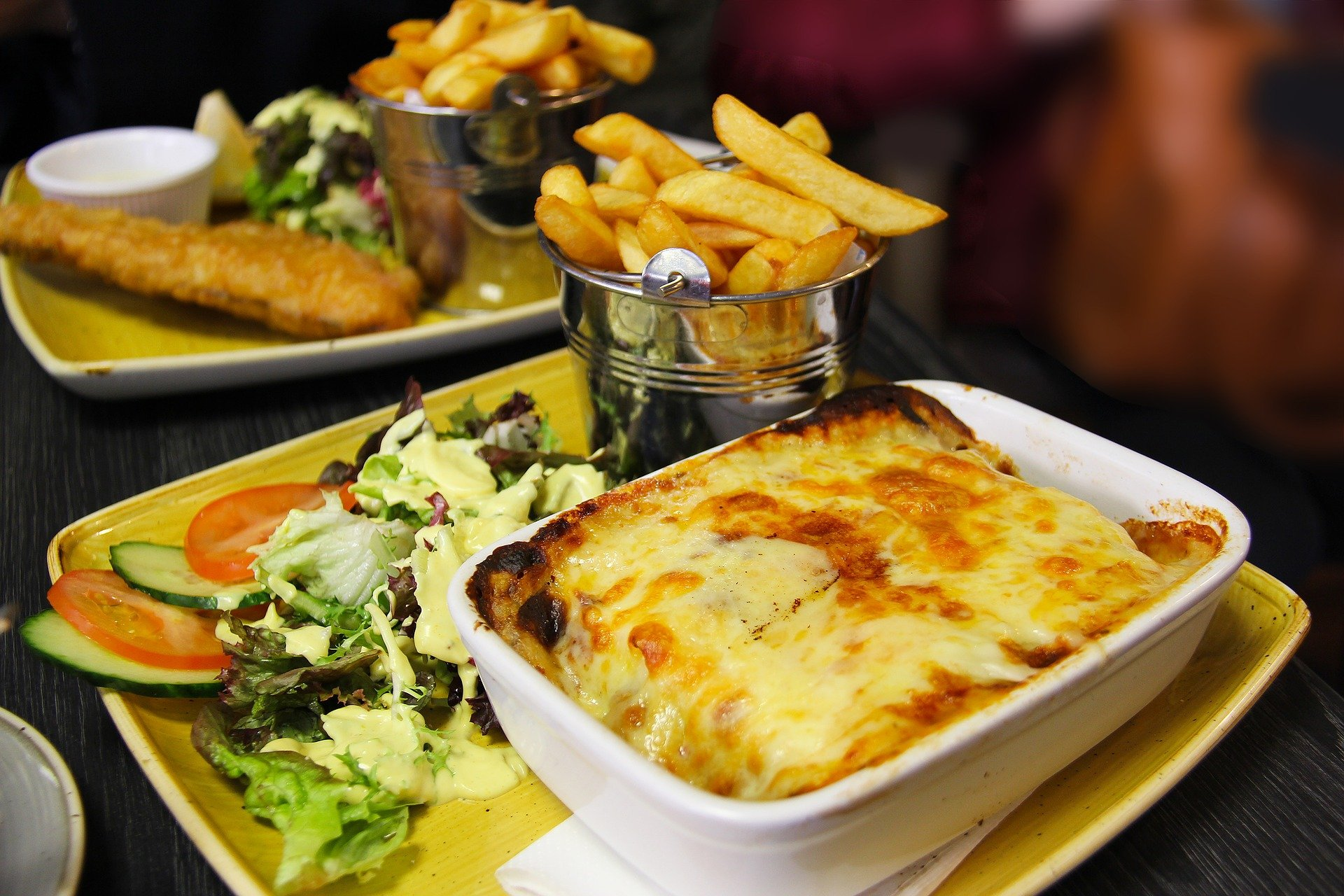 Irish meal of lasagne, chips and fish in the back.