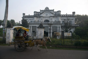 A-horse-drawn-carriage-popular-mode-of-tourist-transport-in-Murshidabad-runs-in-front-of-Wasif-Manzil
