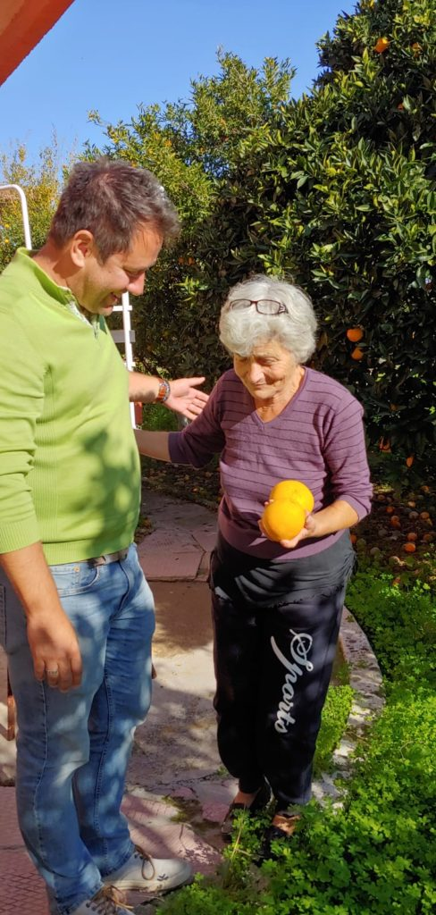 Author's cousin sharing oranges. Photo: Jim Bamboulis