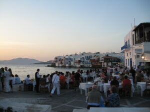 Group of people take in a sunset from Mykonos. Photo: Jim Bamboulis