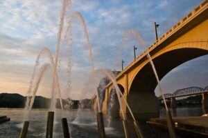 Chattanooga bridge at sunset with water canons