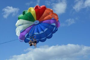 rainbow parasail for LBGTQ gay family travel