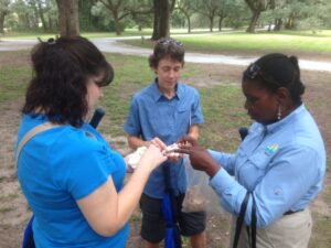 Tour guide showing cotton to visitors at the McLeod Plantation. Photo courtesy of McLeod Plantation Historical Site