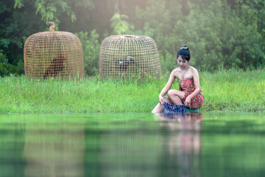 Fashionable-Laos-woman-doing-laundry-at-river