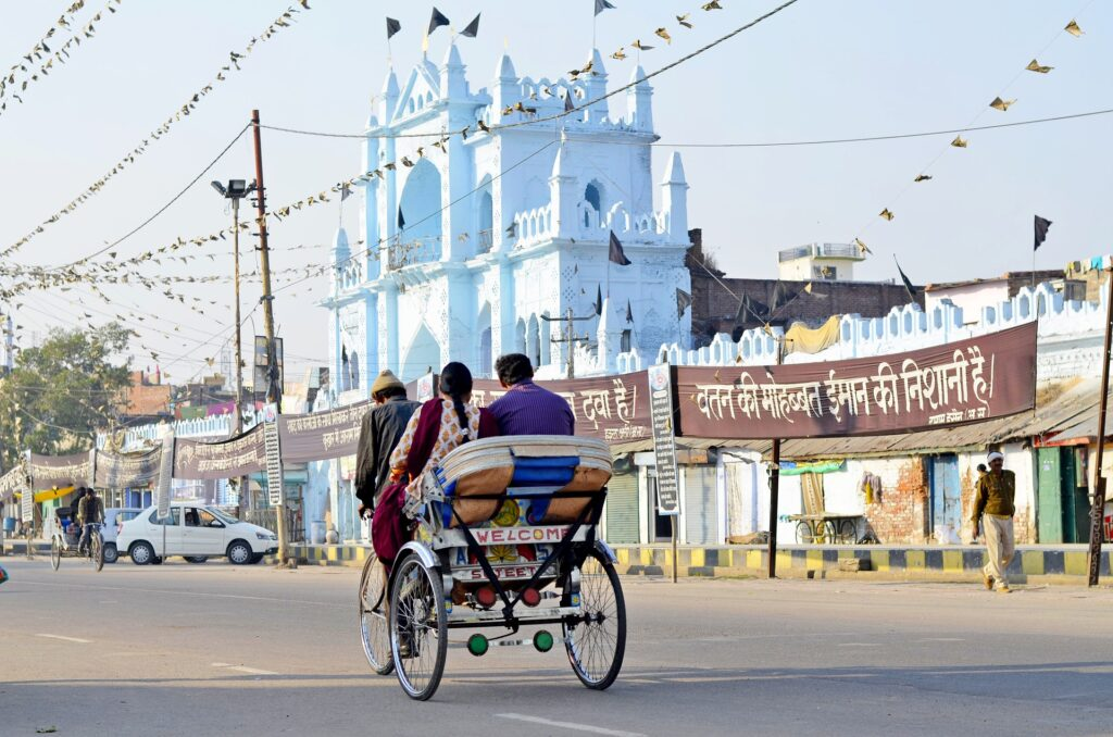 Richshaw traveling the streets of urban Lucknow.